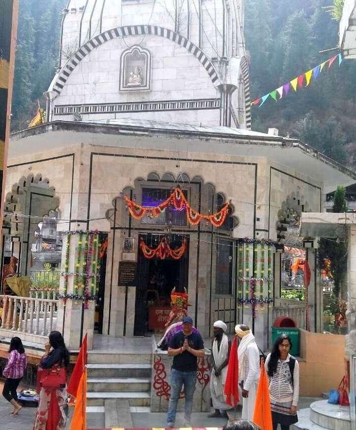 kuldeep manali honeymoon trip: posing outside manikaran temple