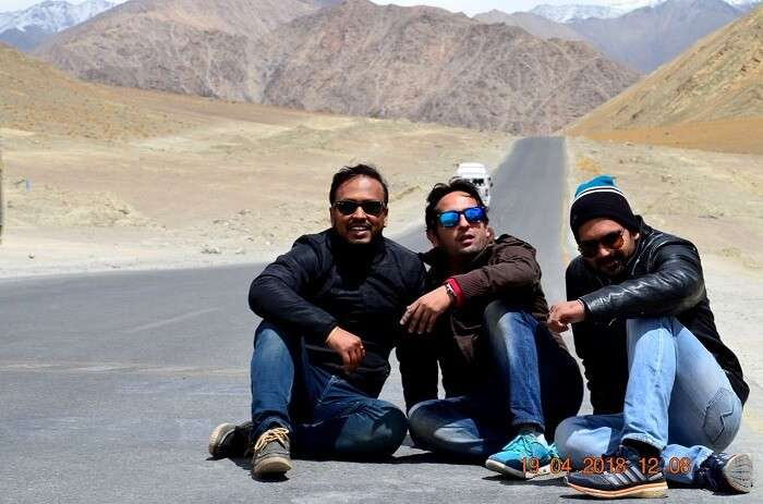 friends chilling on road in leh