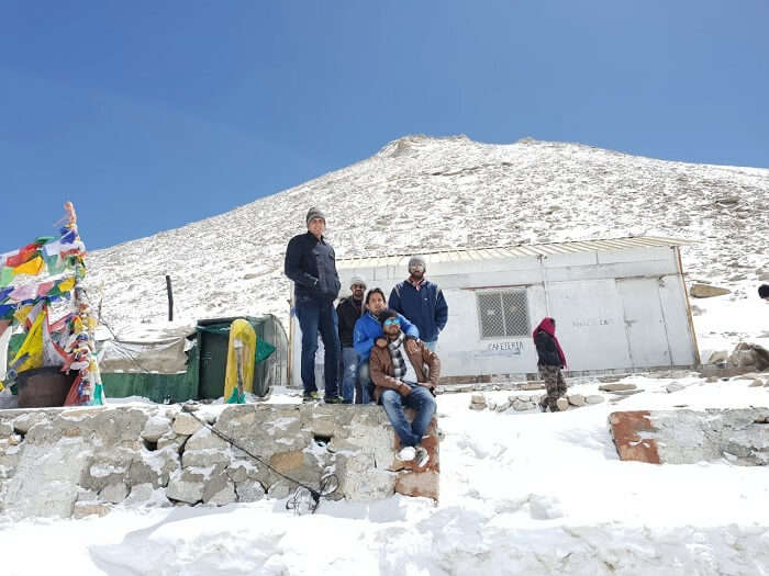 friends enjoying in ladaakh in snowfall