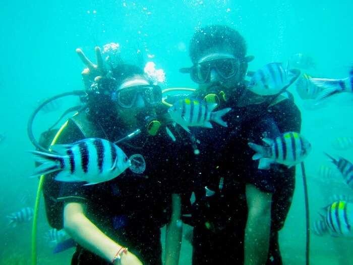couple doing scuba diving