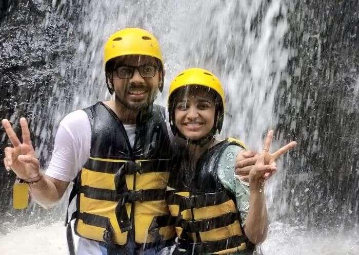 couple near waterfall in ayung bali