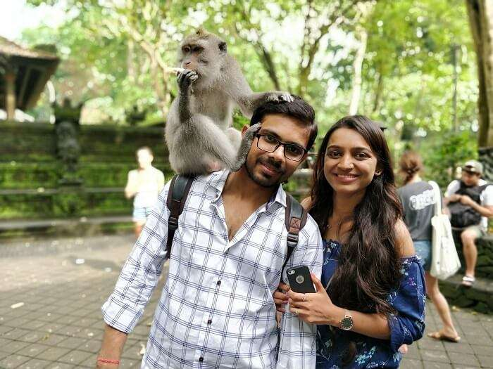 coupleposing with monkey