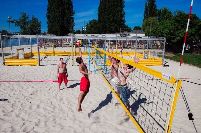 indulge in a game of beach volleyball