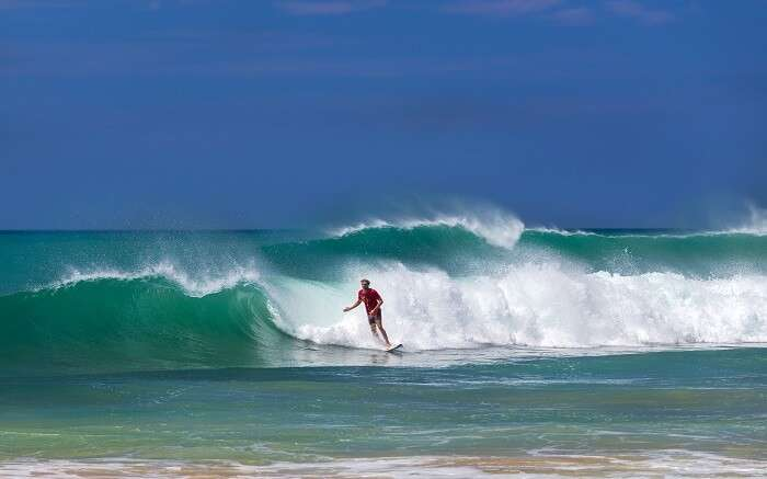 a man surfing on high tides ss01052018