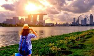 woman looking at singapore skyline in june
