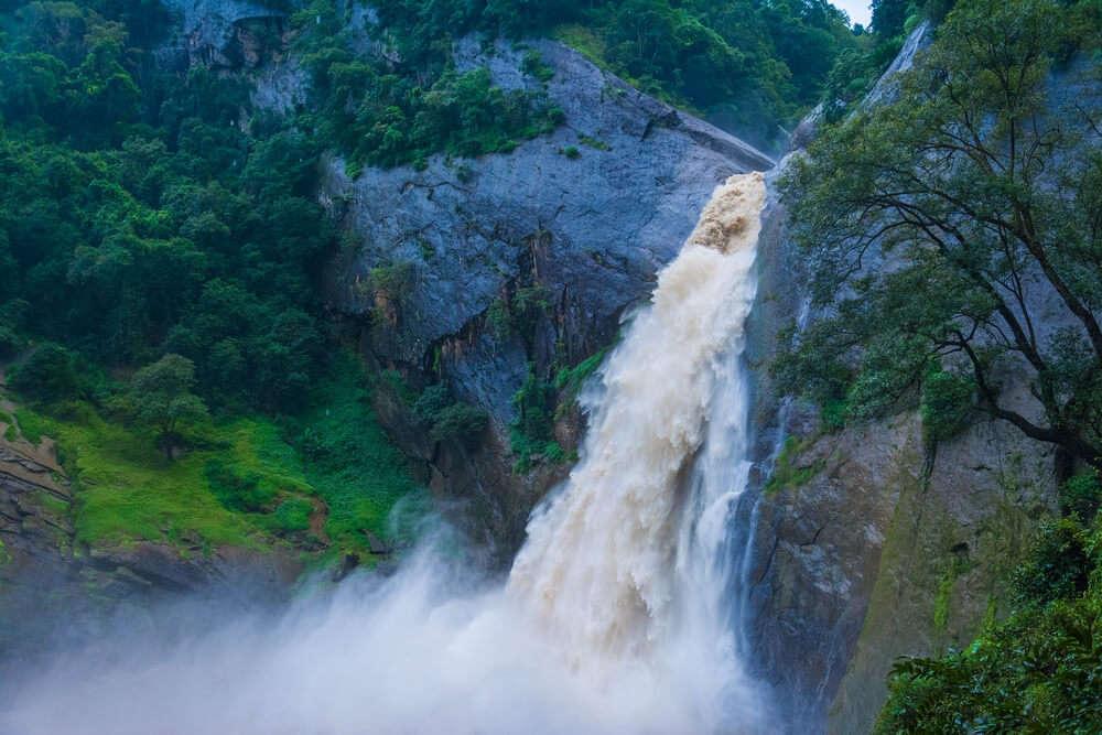 a waterfall in Sri Lanka during rain