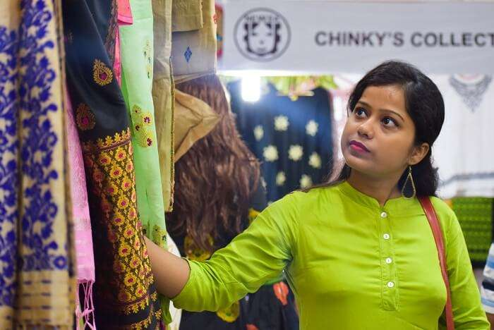 NEDFi Haat Guwahati woman shopping sarees