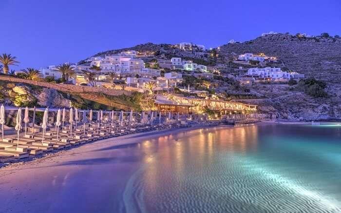 Santa Marina resort from the beach at night