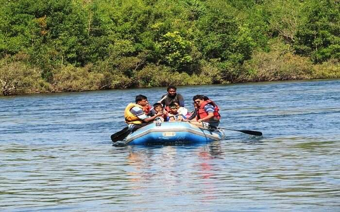 Tourists on blue waters doing river rafting