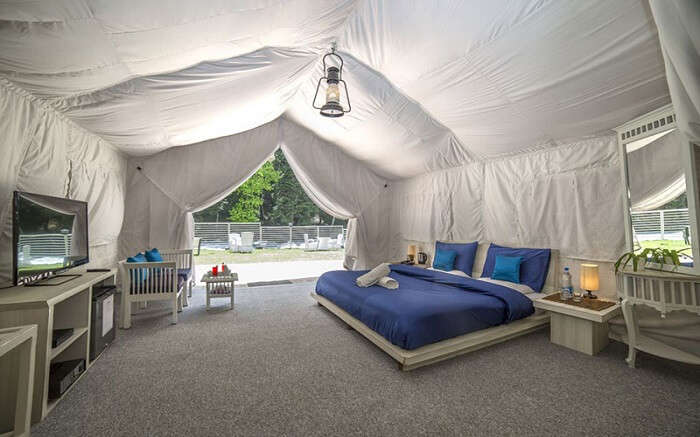 a gorgeous blue bed in a tent style Ahsan Mount Resort