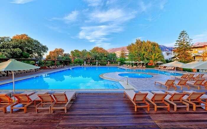 an outdoor pool with wooden sundecks around it