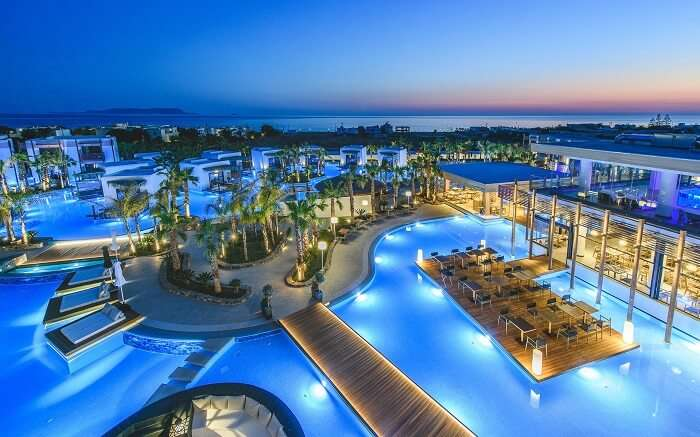 beautifully lit resort with outdoor pools and sitting areas