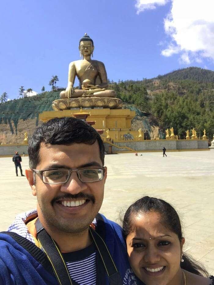 mahesh bhutan trip selfie at statue of buddha