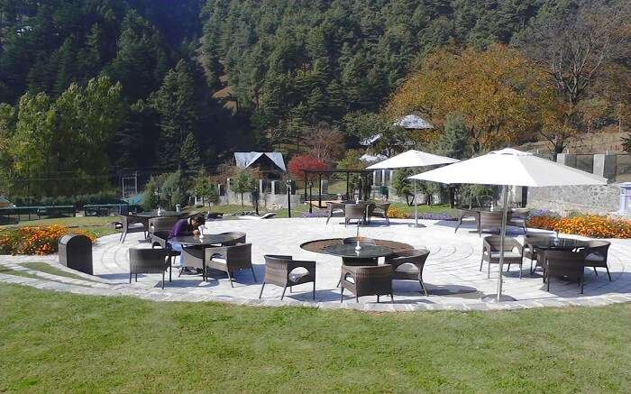 outdoor restaurant of Kolahoi Green Resort amid mountains