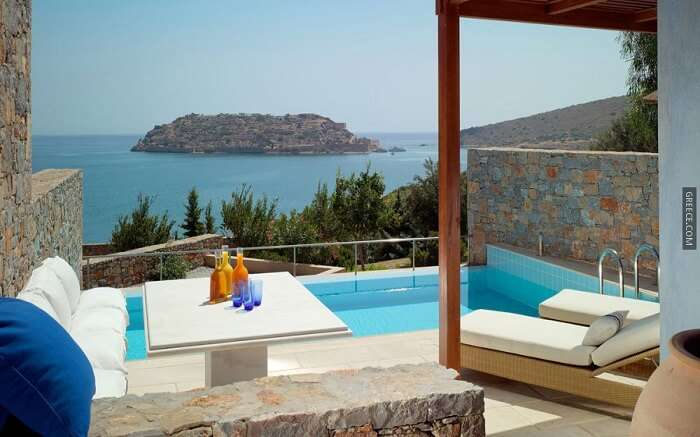 pool cum sitting area overlooking the sea in Greece