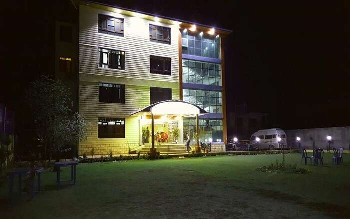 the well lit Triden Kashmir Resort at night