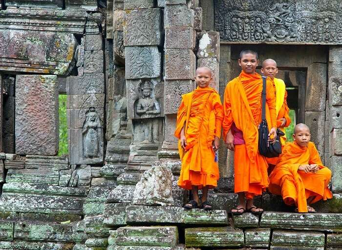monastery complex with kids standing