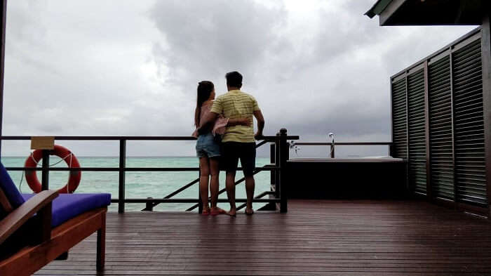couple looking at view in maldives