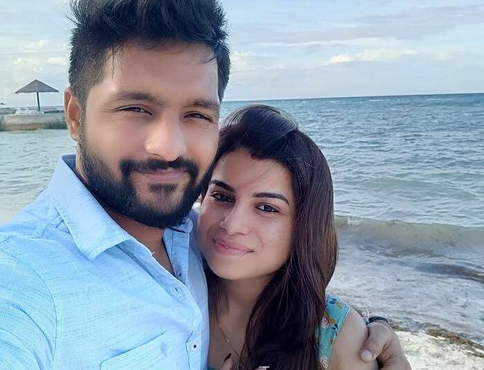 couple clicking selfie on beach