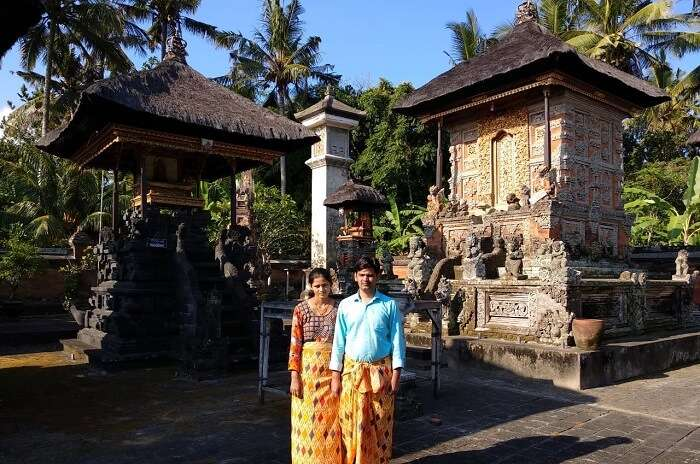 couple outside temple in bali