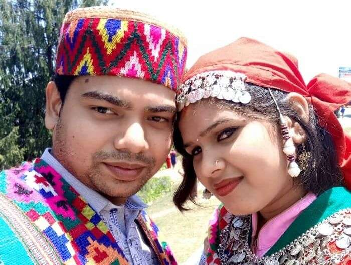 couple posing in himachali outfits