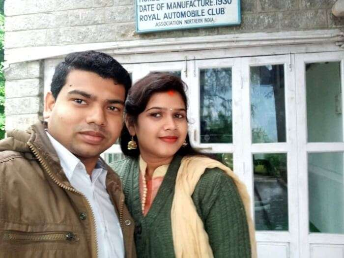 couple clicking selfie outside castle
