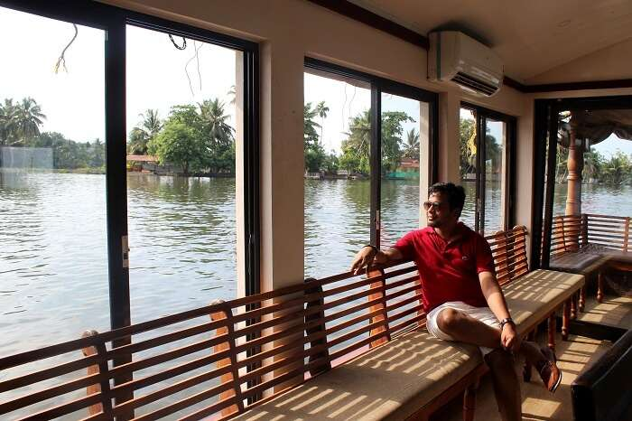 man looking out from a houseboat