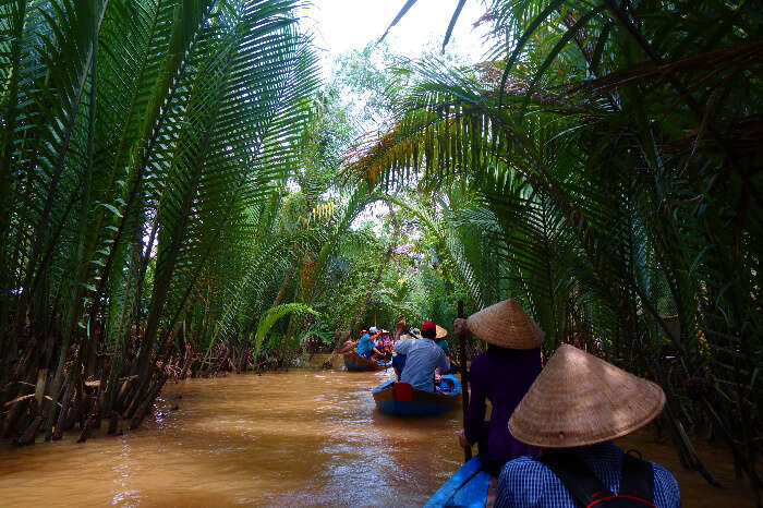 Tourists exploring Mekong River in Ho Chi Minh on boats