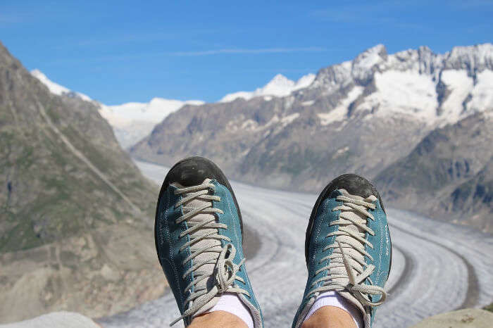 A pair of shoes with snow mountains in the background