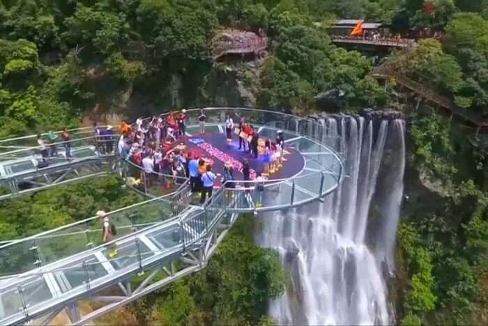 World's Largest Glass Skywalk In China waterfall view