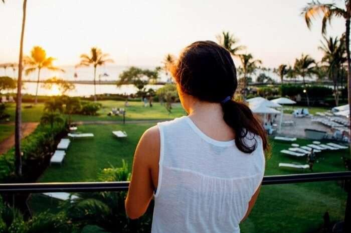 woman in balcony in kerala hotel