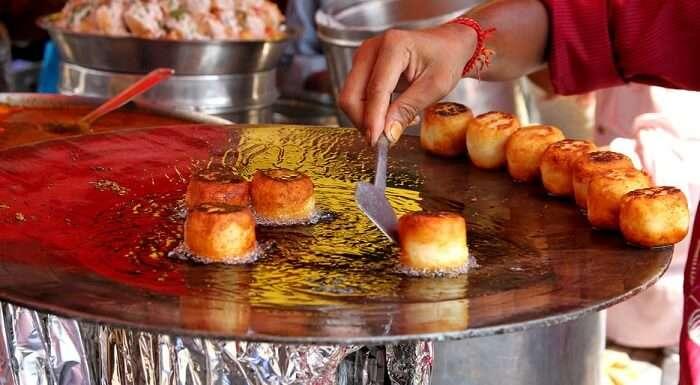 Man cooking Pao Bhaji