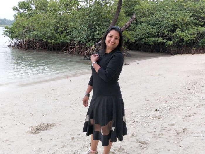 posing on beach in black