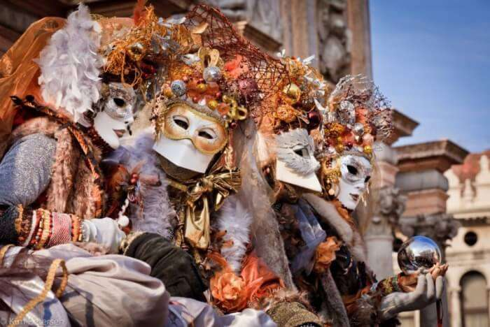 people in Venetian mask during Venice Carnival