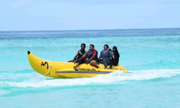 A group of tourists fun tubing in Maldives