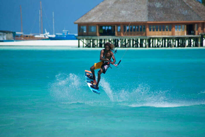 A man enjoying kite surfing in Maldives