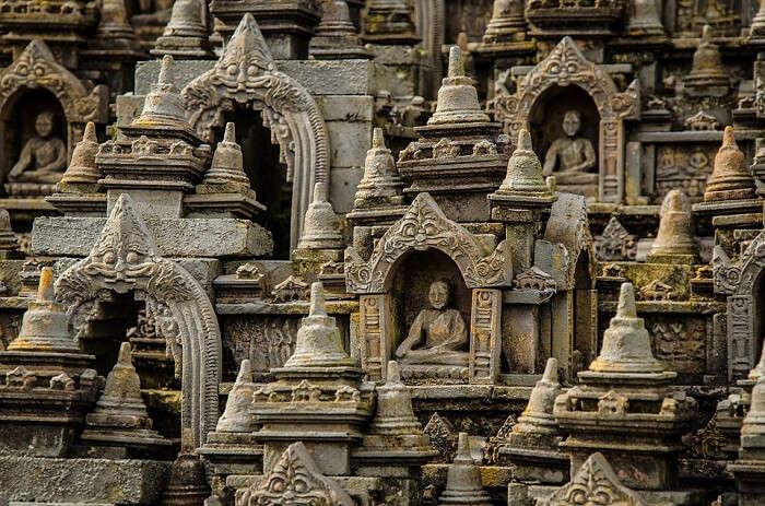 small statues of Buddha