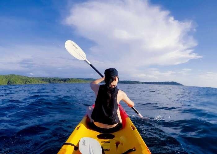 man in a yellow kayak