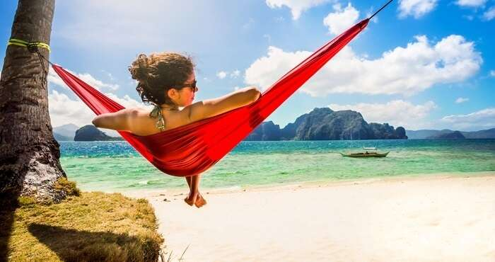 woman relaxing on hammock in cebu philippines