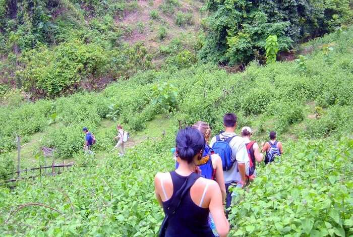 people trekking through pha toe-boo cliff