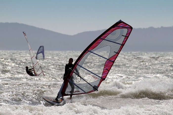 man doing windsurfing