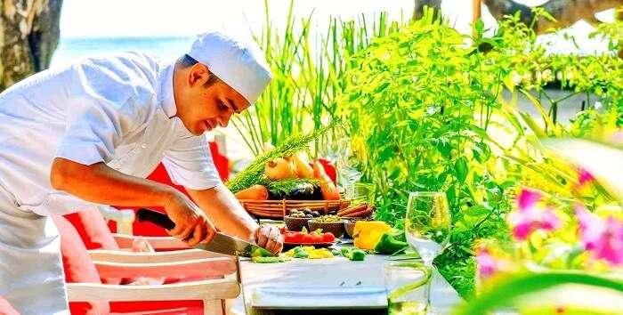 chef displaying preparation of Maldivian cuisine