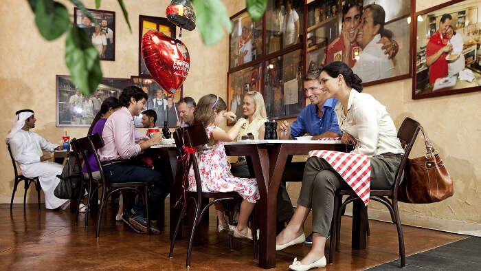 A family enjoying food at a restaurant in Ferrari World