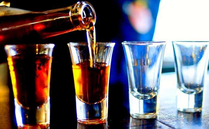 serving rum in small glasses