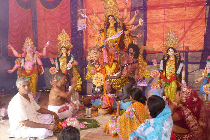 Goddess Durga's idol being worshiped in a gathering