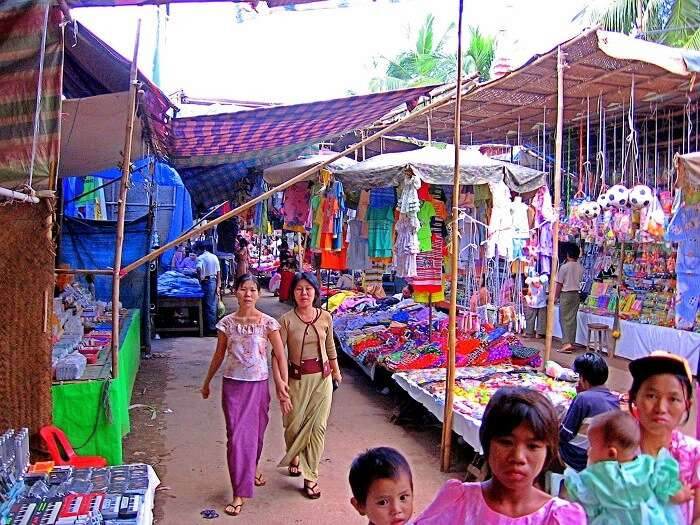 Women buying things from the street market in Myanmar