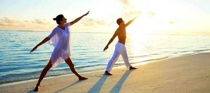 morning yoga session couple
