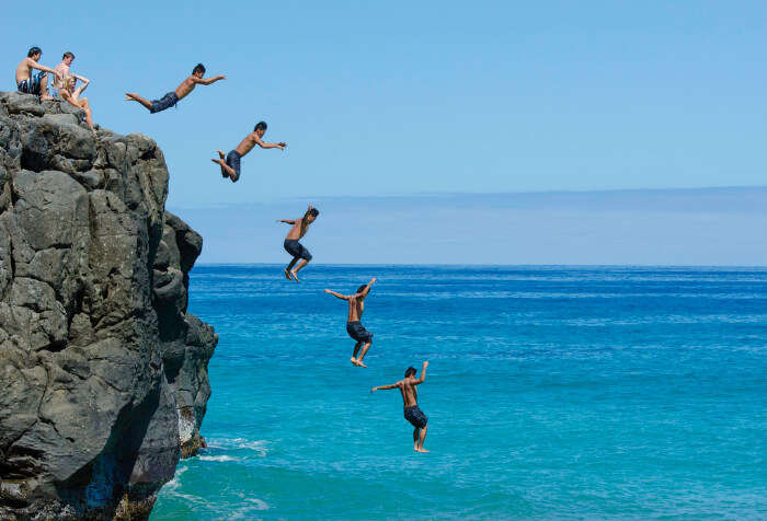 Man jumping from Rocks