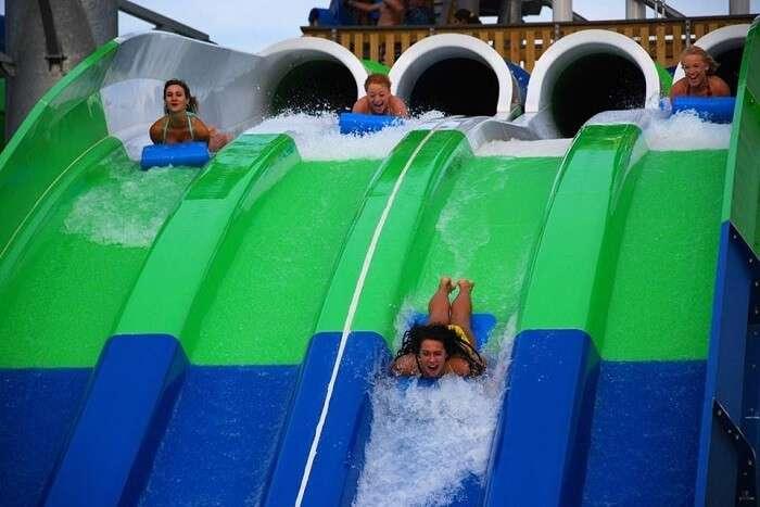 man sliding in water