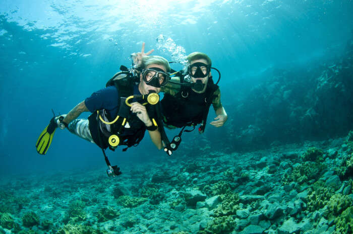 Two scuba divers under the ocean